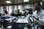 Egyptian Staff process blood donations at a National Blood Transfusion Services (NBTS) Center June 16, 2015 in Cairo, Egypt. At smaller private blood banks in Egypt, many blood transfusions are screened with older, fallible  antibody tests that miss some infections, complicating the national fight against blood-borne viruses such as Hepatitis C. (Photo by Scott Nelson, for the New York Times)