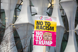 © Licensed to London News Pictures. 20/01/2018. London, UK. An anti-Donald Trump placard at a demonstration outside the new American Embassy in Nine Elms on the first anniversary of Trump's inauguration as US President. Trump has cancelled his planned February 2018 visit to the UK and has described the new embassy as a 'bad deal'. Photo credit: Rob Pinney/LNP