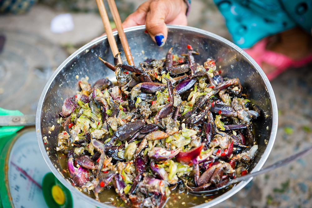 Crab dish at street stall in a market in Saigon