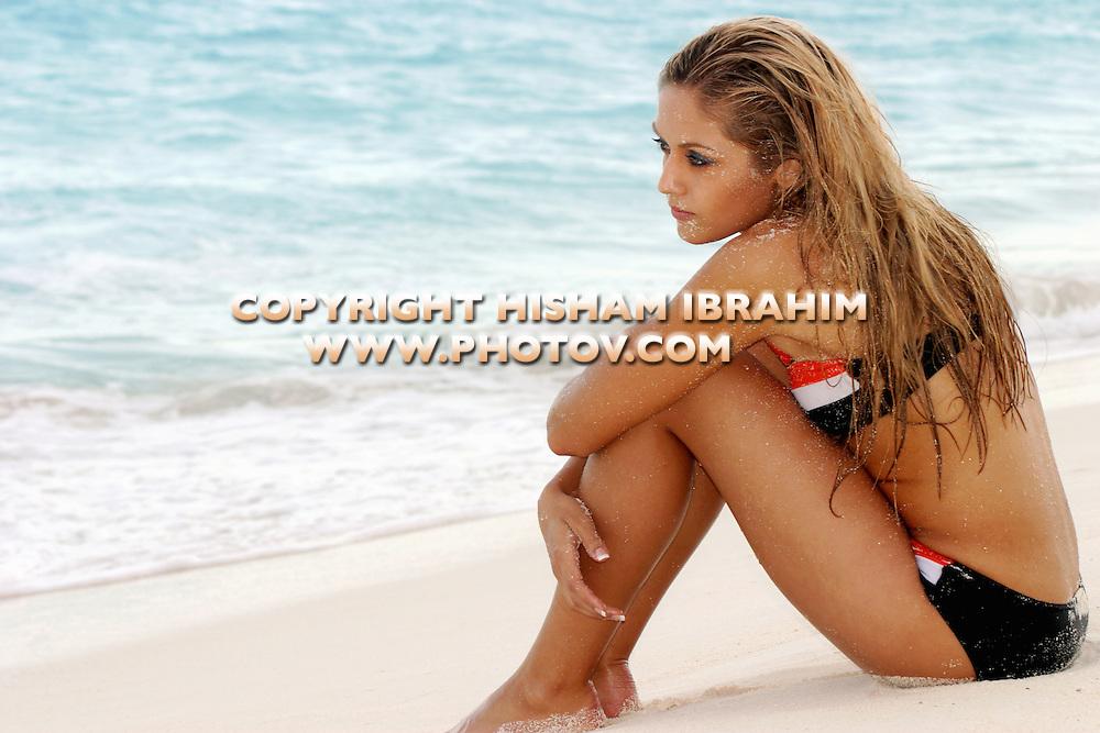 Sexy Blonde woman in bikini on the beach, Cancun, Mexico