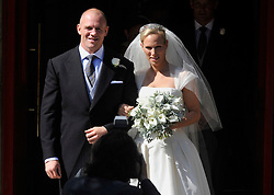 EDINBURGH, SCOTLAND- JULY 30: ROTA- The Royal Wedding of Zara Phillips, Granddaughter of Queen Elizabeth and Mike Tindall, England Rugby Player takes place at Cannongate Kirk in Edinburgh, Scotland. Members of the Royal Family attend the service at the church followed by a reception at Holyrood Palace.<br /> Pic shows. Zara Phillips and Mike Tindall<br /> Photo by Tristan Gregory, supplied by Ian Jones Photography Ltd