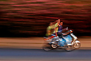 Two young Moroccans on a common mode of transportation in Fes, Morocco on Sunday evening, June 10, 2007 travel down a road hands extended. The spirit of the young people here in Morocco can be seen everywhere. (PHOTO BY TIMOTHY D. BURDICK).