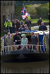 HM The Queen accompanied by HRH The Duke of Edinburgh and HRH The Prince of Wales taking a ride on a barge on the Liverpool Leeds canal in Burnley where they toured a renovated mill. Photo By i-images