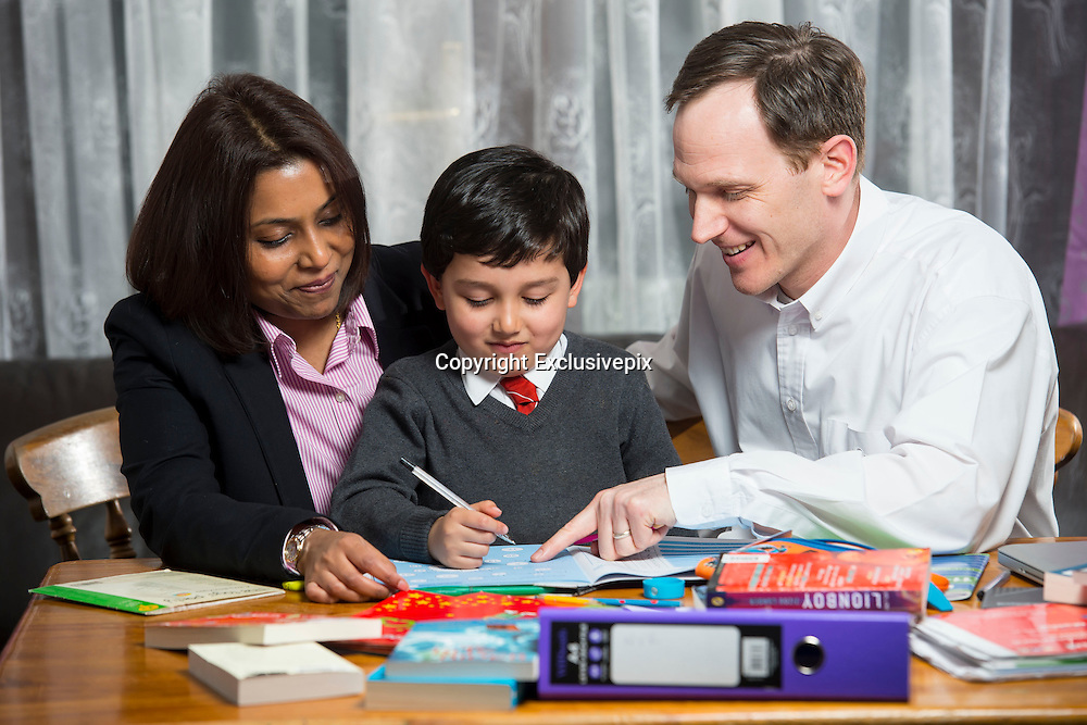 EXCLUSIVE - UK's youngest tutored child  jaayen, 4 years old, is tutored 13 hours a week and has homework of 3 hours a day, mum Tj ray and dad marcus ray, say they stand by there child being tutored because of the state of the schools and dont feel there pushed enough <br /> in class<br /> Photo shows:  jaayen, 4 years old and is home tutored as well as attending school pictured with mum  Tj ray and dad Marcus , feels her son is not pushed hard enough in school and says its her responsibility to get both her children in to a good secondary school<br /> &copy;Exclusivepix