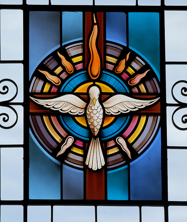 Stained glass image of the Holy Spirit. (Sam Lucero photo)