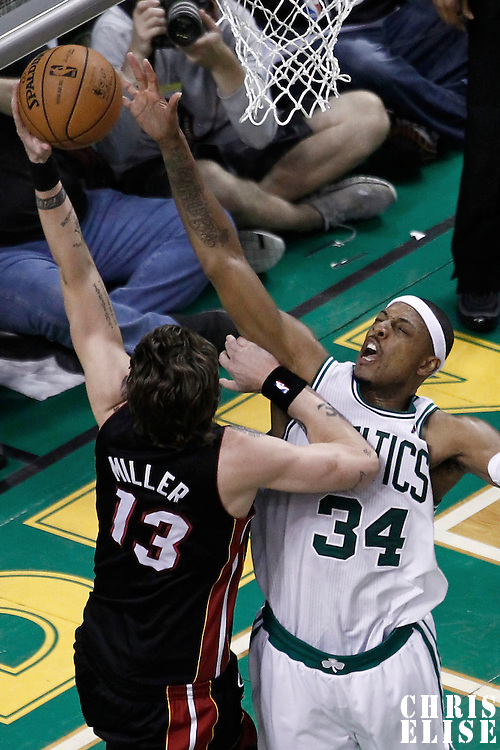 01 June 2012: Miami Heat shooting guard Mike Miller (13) goes to the basket over Boston Celtics small forward Paul Pierce (34) during the Boston Celtics 101-91 victory over the Miami Heat, in Game 3 of the Eastern Conference Finals playoff series, at the TD Banknorth Garden, Boston, Massachusetts, USA.