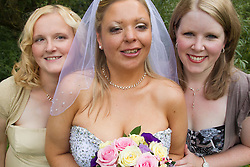 Visually impaired bride with attendants.