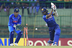 August 27, 2017 - Kandy, Sri Lanka - Sri Lankan captain Chamara Kapugedera(R)  is bowled out as Indian Wicketkeeper MS Dhoni looks on during the 3rd One Day International cricket match between Sri Lanka and India at the Pallekele international cricket stadium at Kandy, Sri Lanka on Sunday 27 August 2017. (Credit Image: © Tharaka Basnayaka/NurPhoto via ZUMA Press)