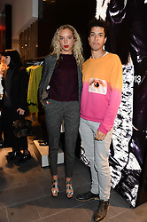 PHOEBE COLLINGS-JAMES and SEAN FRANK at the opening of the Tiger of Sweden Store, 210 Piccadilly, London on 3rd October 2013.