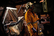 Heidon Norris, 58, is checking the coal density at the Washery, a section of the Coal Processing Plant at Tower Colliery, the last deep mine in Wales, on Tuesday, June 19, 2007, in Hirwaun, Vale of Neath, South Wales. The time is ripe again for an unexpected revival of the coal industry in the Vale of Neath due to the increasing prize and diminishing reserves of oil and gas, the uncertainties of renewable energy sources, and the technological advancement in producing energy from coal while limiting emissions of pollutants, has created the basis for valuable investment opportunities and a possible alternative to the latest energy crisis. Unity Mine, in particular, has started a pioneering effort to revive the coal industry in the area, reopening after more than 8 years with the intent of exploiting the large resources still buried underground. Coal could be then answer to both, access to cheaper and paradoxically greener energy and a better and safer choice than nuclear energy as a major supply for the decades to come. It is estimated that coal reserves in Wales amount to over 250 million tonnes, or the equivalent of at least 50 years of energy supply, while the worldwide total coal could last for over 200 years as a viable resource compared to only a few decades of oil and natural gas.