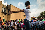 BALTIMORE, MD -- 7/1/16 -- Tyonna Worley from the Couture Dolls performs for fans at the block party in memory of Lor Scoota. <br /> Block party in memory of  Tyriece Watson, also known as Lor Scoota, a Baltimore rapper who was shot and killed after leaving a charity basketball game on June 24th&hellip;by Andr&eacute; Chung #_AC21181