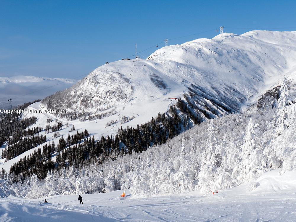 View of ski runs on mountain above Åre ski resort in Sweden