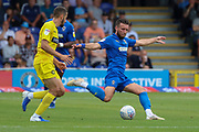 AFC Wimbledon defender Luke O'Neill (2) passing the ball during the EFL Sky Bet League 1 match between AFC Wimbledon and Wycombe Wanderers at the Cherry Red Records Stadium, Kingston, England on 31 August 2019.
