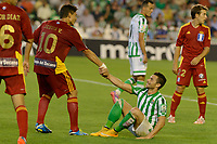 Jesus Vazquez (L) helps her up to Ruben Castro (R) during the match between Real Betis and Recreativo de Huelva day 10 of the spanish Adelante League 2014-2015 014-2015 played at the Benito Villamarin stadium of Seville. (PHOTO: CARLOS BOUZA / BOUZA PRESS / ALTER PHOTOS)