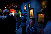 "Hans Iselborn, 9, listens to his audio tour as they enter the ""Harry Potter"" exhibition at Discovery Times in New York. ..Photo by Robert Caplin."