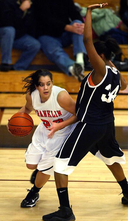 01/07/2010 -  Franklin's Shoni Schimmel (23 drives hard around Wilson's Kiki Marion (34). Franklin beat Wilson 75-51.
