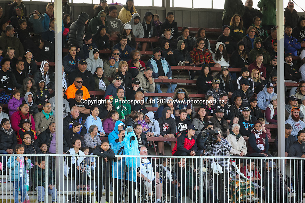 Spectators watch the game from the main grandstand. Rugby League match - NZ Residents v NZ Maori XIII played at Davies Park, Huntly, New Zealand on Saturday 15 October 2016.