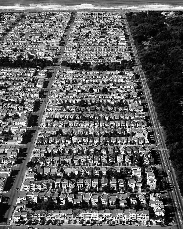 Aerial view of San Francisco row houses with Ocean Beach 1940's and 1950's