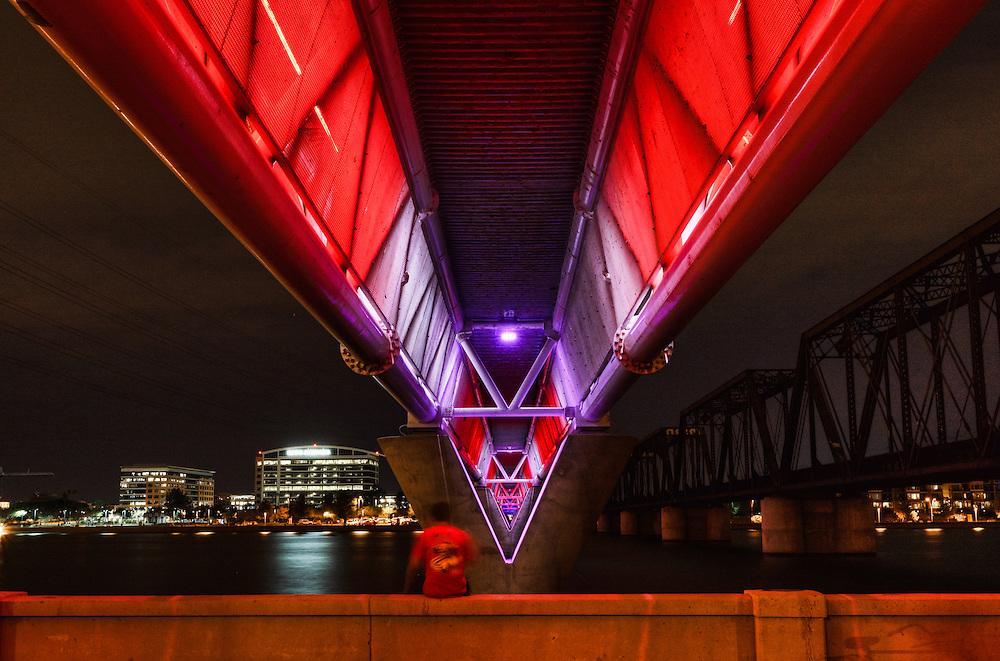 Light rail bridge over Tempe Town Lake at night