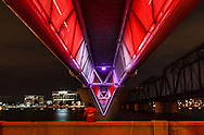 Light rail bridge over Tempe Town Lake at night