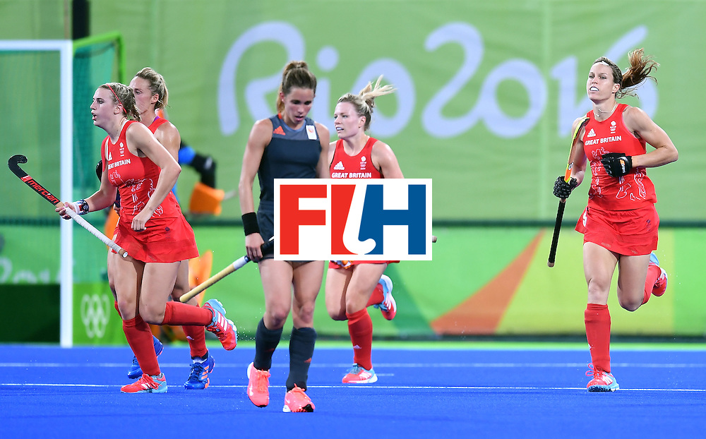 Britain's Crista Cullen (R) runs after scoring a goal during the women's Gold medal hockey Netherlands vs Britain match of the Rio 2016 Olympics Games at the Olympic Hockey Centre in Rio de Janeiro on August 19, 2016. / AFP / MANAN VATSYAYANA        (Photo credit should read MANAN VATSYAYANA/AFP/Getty Images)