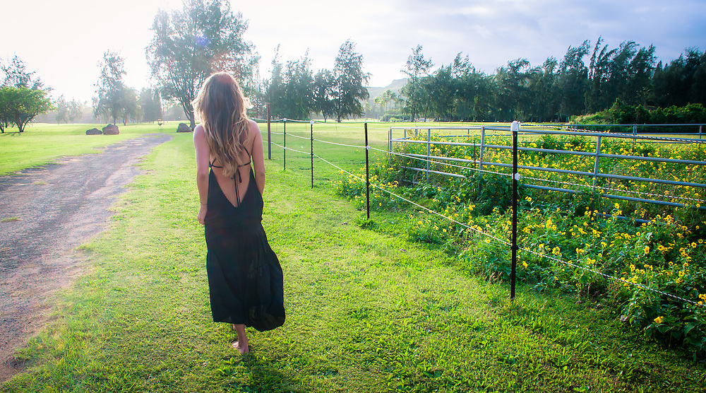 Woman in field wearing Tiare Hawaii Lanai Dress in Black<br />