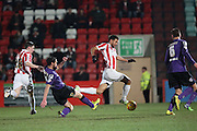 Liverpool loanee, Kevin Stewart during the Sky Bet League 2 match between Cheltenham Town and Morecambe at Whaddon Road, Cheltenham, England on 16 January 2015. Photo by Shane Healey.