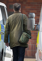 © Licensed to London News Pictures. 21/03/2018. Salisbury, UK. A man carries what is believed to be a gas mask in ashoulder bag as Investigators from the Organisation for the Prohibition of Chemical Weapons (OPCW)  arrive at The Mill pub in Salisbury aspolice continue their investigation after former Russian spy Sergei Skripal was taken after he and his daughter Yulia were poisoned with nerve agent. The couple where found unconscious on bench in Salisbury shopping centre. A policeman who went to their aid is currently recovering in hospital. Photo credit: Peter Macdiarmid/LNP