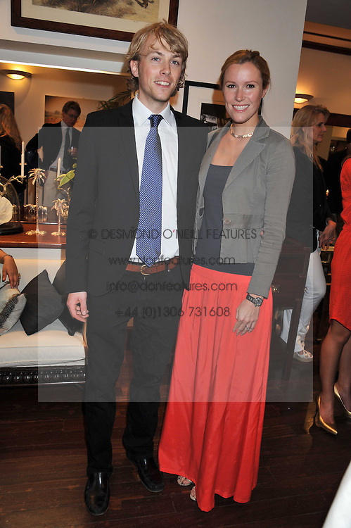 HAL MESSEL and CHARLOTTE MORE-NISBETT at a party to celebrate the launch of the new Mauritius Collection of jewellery by Forbes Mavros held at Patrick Mavros, 104-106 Fulham Road, London SW3 on 5th July 2011.