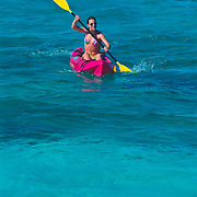 Woman kayaking. Cancun, Quintana Roo. Mexico.