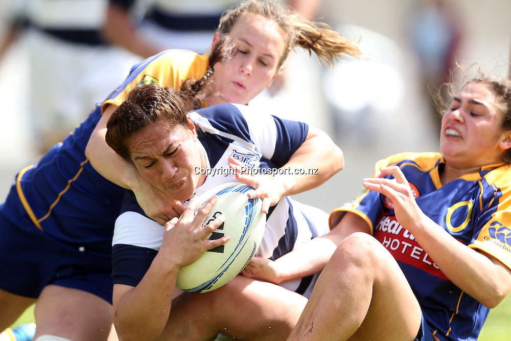 Auckland Storm replacement Doris Taufateau crashes between Otago halfback Rebecca Todd(left) & first five Sheree Hume to score late in the Auckland Storm & Otago Womens Provincial Championship rugby match at Western Springs Stadium, 28 September 2013. Photo: Jason Oxenham / www.photosport.co.nz