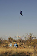 Water station established and maintained by Humane Borders to provide water to undocumented migrants crossing the Buenos Aires National Wildlife Refuge in the Sonoran Desert, north of Sasabe, Arizona, USA.  A blue flag indicates the location of the station located to the east of Baboquivari Peak.  A flag placed on the water container represents opposition to the water station and the Continental Navy and The Sons of Liberty, who were responsible for the Boston Tea Party.