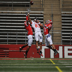 Apr 18, 2009; Piscataway, NJ, USA; Rutgers WR Keith Stroud (83) goes up for a jump ball against DBs Al-Majid Hutchins (41) and Wayne Warren (27) during the first half of Rutgers' Scarlet and White spring football scrimmage.