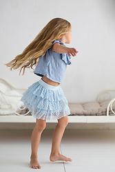 Young Girl Dancing in Bedroom