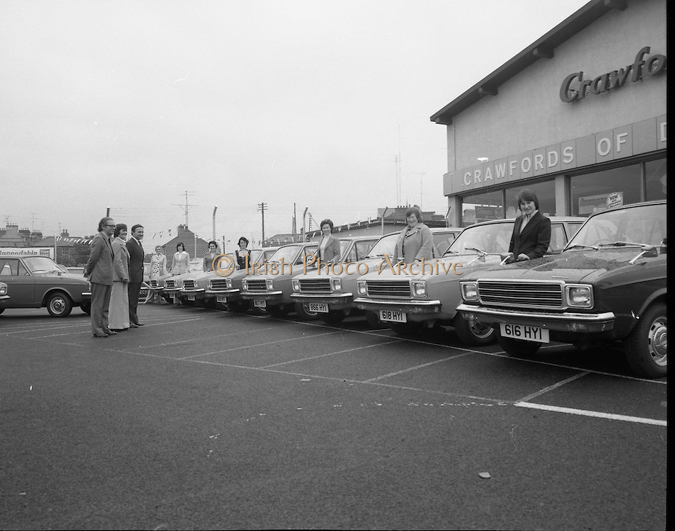 Tubberware Girls - New Cars 31/05/1976.05/31/1976.31st May 1976.Pictured from left to right Michael Rowe, Managing Director  Crawfords Dun Laoghaire, Loise Coleman, Tupperware Distributor, Michael Rowe, Managing Director, Chrysler (Ireland) Limited, Kay Magee, Mary Anderson, Eileen Halre, Marie Fely - Henry, Brid Molone, Maureen Monaghan and Elizabeth Farrell. The cars in the picture are Hillman Hunters.