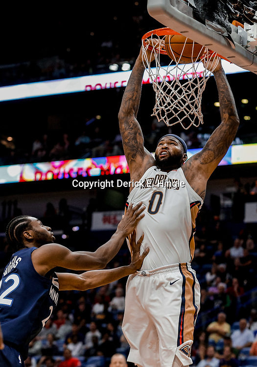 Nov 1, 2017; New Orleans, LA, USA; New Orleans Pelicans center DeMarcus Cousins (0) dunks over Minnesota Timberwolves forward Andrew Wiggins (22) during the second half of a game at the Smoothie King Center. The Timberwolves defeated the Pelicans 104-98. Mandatory Credit: Derick E. Hingle-USA TODAY Sports