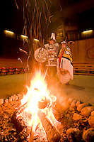 Two Hereditary chiefs preside over a fire  in the longhouse in Port Rupert.  Port Rupert, Vancouver Island, British Columbia, Canada.