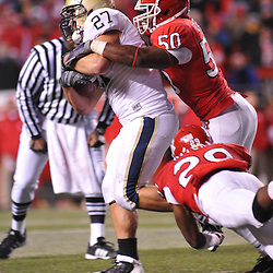 Oct 16, 2009; Piscataway, NJ, USA; Rutgers linebacker Antonio Lowery (50) and cornerback Zaire Kitchen (29) tackle Pittsburgh fullback Henry Hynoski (27) during second half NCAA football action in Pittsburgh's 24-17 victory over Rutgers at Rutgers Stadium.