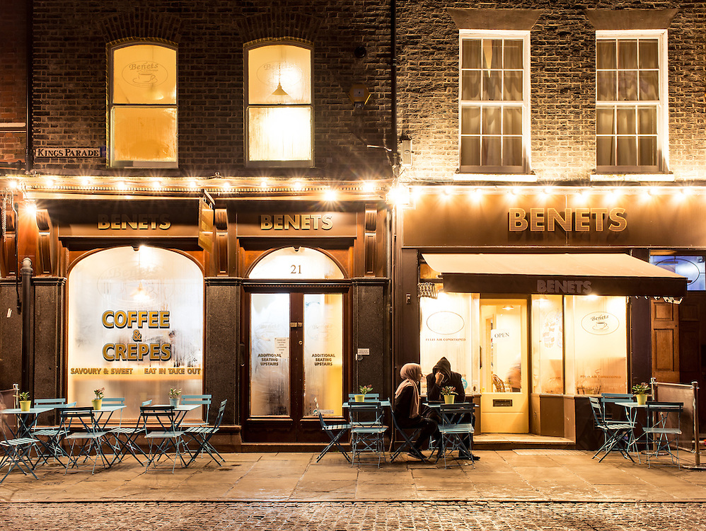 A couple haveing a hot drin on a cold February night in Cambridge