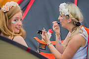 Preparations include applying glitter and lipstick - The 2016 Glastonbury Festival, Worthy Farm, Glastonbury.