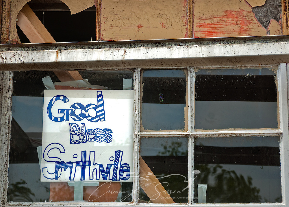 A sign taped to the window of the old post office greets passersby with a message of faith on May 1, 2011 in Smithville, Miss. Sixteen people died in the town during the April 27, 2011 EF5 tornado, part of a storm system that swept across six states in the South, killing 342 people and injuring thousands. (Photo by Carmen K. Sisson/Cloudybright)