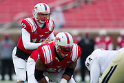 DALLAS, TX - DECEMBER 7: Neal Burcham #12 of the SMU Mustangs calls a play against the Central Florida Knights on December 7, 2013 at Gerald J. Ford Stadium in Dallas, Texas.  (Photo by Cooper Neill) *** Local Caption *** Neal Burcham