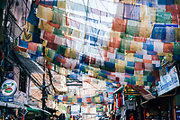 Prayer flags hang across a busy street in Thamel, Kathmandu.