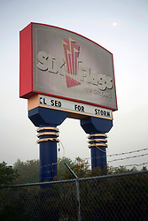 24th November 2010. New Orleans, Louisiana, USA. <br /> <br /> Not amusing any more. <br /> <br /> 'Closed for storm.' Six Flags amusement park radiates an eerie post apocalyptic sense of foreboding in it's abandonment. The park was destroyed by hurricane Katrina , stripped by copper thieves and is slowly being reclaimed by the land it stands on. It is slated for demolition in January 20111 following a lease dispute between the City and Six Flags. <br /> Photo; Charlie Varley/varleypix.com