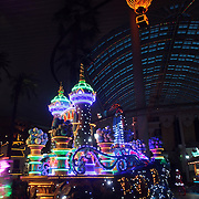 The night time parade with colorful illuminated floats and characters viewed from the Lotte World Hotel bar. Lotte World is the world's largest indoor theme park which includes shopping malls, a luxury hotel, and an Ice rink. Opened on July 12, 1989, Lotte World receives over 8 million visitors each year. Seoul, South Korea. 21st March 2012. Photo Tim Clayton