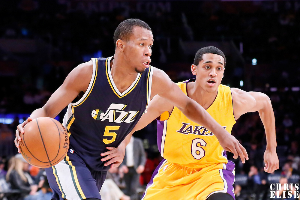 19 March 2015: Utah Jazz guard Rodney Hood (5) drives past Los Angeles Lakers guard Jordan Clarkson (6) during the Utah Jazz 80-73 victory over the Los Angeles Lakers, at the Staples Center, Los Angeles, California, USA.
