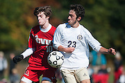Essex's Brennan Goodrich (23) battles for the ball with CVU's Cooper O'Connell (10) during the boys soccer game between the Champlain Valley Union Redhawks and the Essex Hornets at Essex High School on Saturday mooring October 10, 2015 in Essex. (BRIAN JENKINS/For the FREE PRESS)