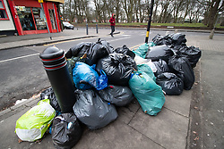 © Licensed to London News Pictures. 20/02/2019. Birmingham, UK. Birmingham bin men work to rule. Pictured, large amounts of uncollected rubbish outside shops in Dora Road, Small Heath. Industrial action by Birmingham waste collection services is resulting in a build up of rubbish on the streets in areas of the City. Photo credit: Dave Warren/LNP