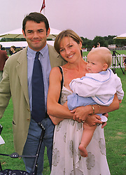 Former England rugby captain WILL CARLING and MISS ALI COCKAYNE with their son HENRY, at a polo match in Berkshire on 26th July 1998.MJG 126