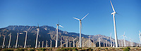 Valley of wind turbines in desert